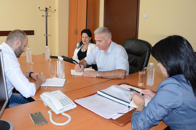 Upravljački tim na sastanku o sportu