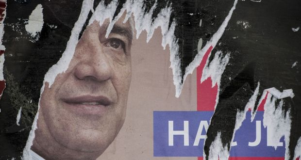 A ripped poster of leading Kosovo Serb politician Oliver Ivanovic who was killed in a brazen drive-by shooting in Mitrovica. Photograph: Armend Nimani/AFP/Getty